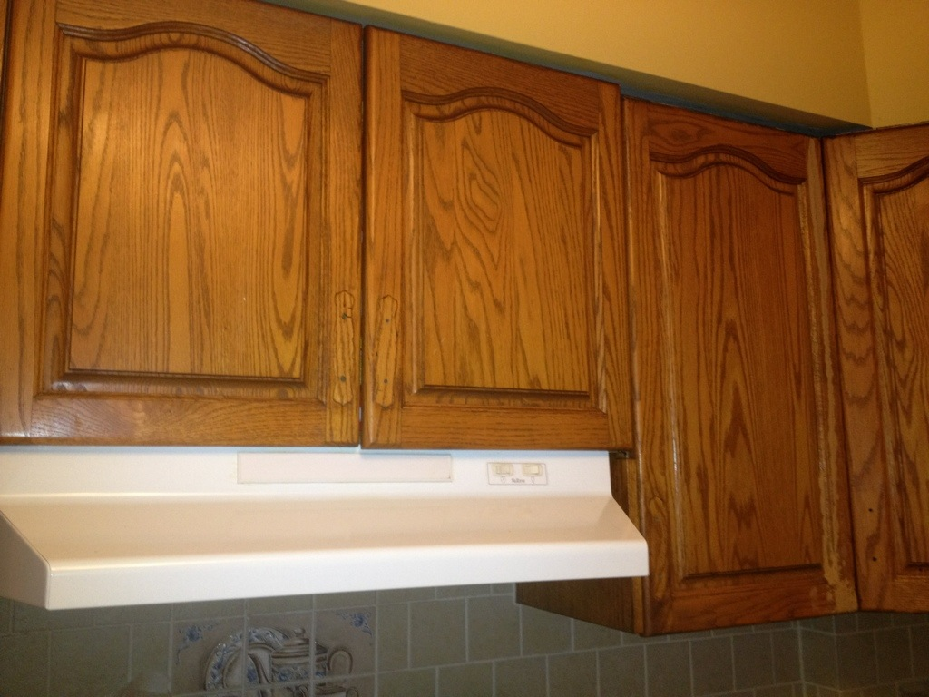 cabinet hardwares and patched all nicks and scratches with wood filler